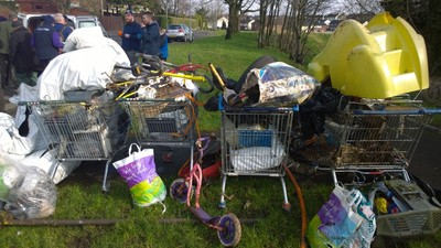 Off our trolleys: litter removed from a small Belfast river by volunteers